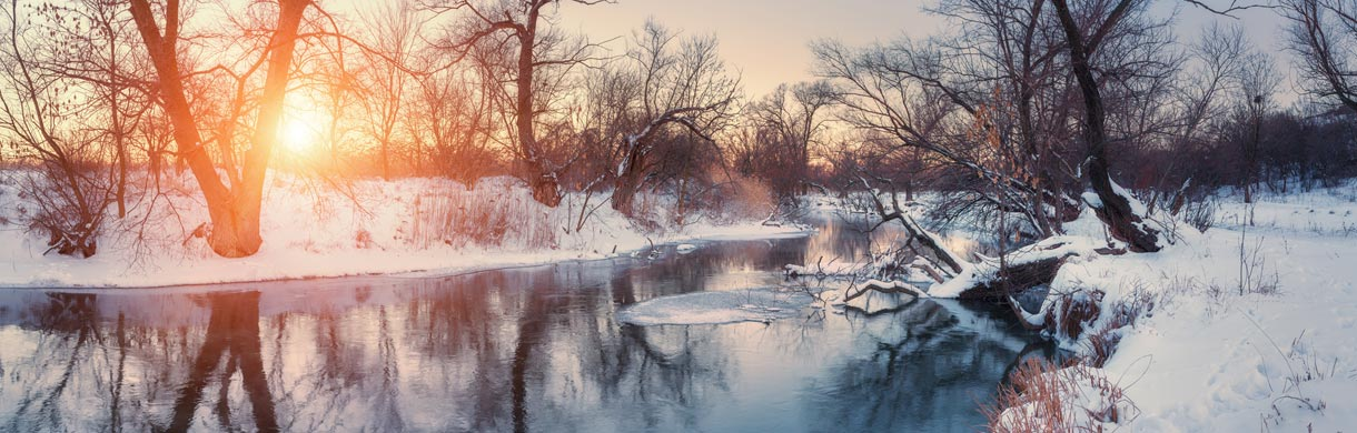 sunrise-at-creek-with-trees-on-banks-in-winter