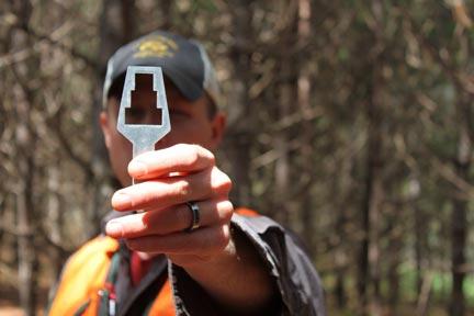 using-prism-to-measure-tree-hight-man-holding-prism